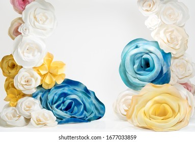 space decorated with large artificial flowers for the background