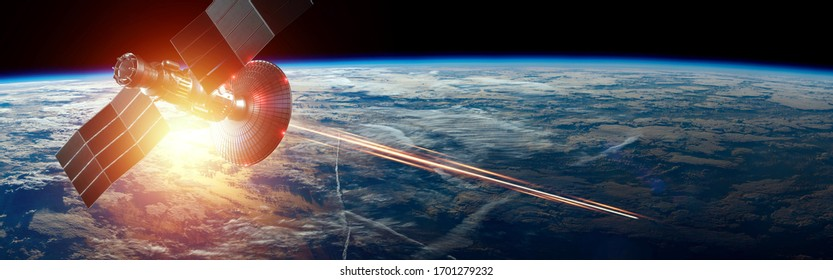 Space military satellite, a weapon in space shoots a laser against the background of the earth. Attack, technology, space war. mixed medium, copy space. image furnished by NASA