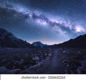 Space. Milky Way and mountains. Fantastic view with mountains and starry sky at night in Nepal. Trail through mountain valley and sky with stars. Himalayas. Night landscape with bright milky way
