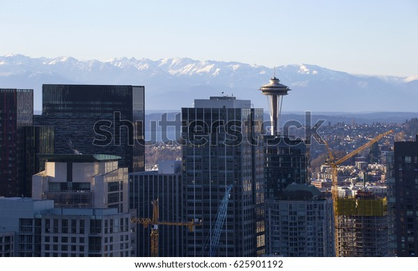 SPACE NEEDLE WITH OLYMPIC MOUNTAINS IN THE BACKDROP, SEATTLE, WA - January 20, 2017: Seattle landmark Space Needle on sunny day.