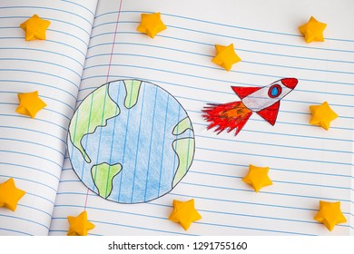 Space Rocket Blasting Off For New Ideas Through Yellow Origami Stars. Close up.