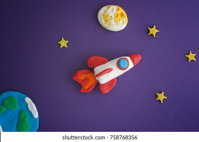 Space Rocket Blasting Off For New Ideas. Earth, space rocket, Moon and stars are made out of play clay (plasticine).