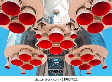 Space rocket engine on blue sky background