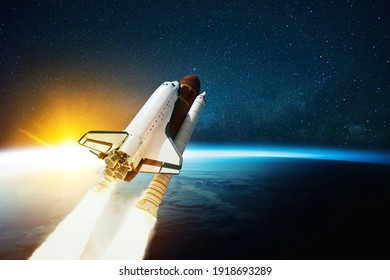 Space rocket flies in outer space with blue planet Earth and amazing sunset. Spaceship on a mission and is flying in cosmos with stars. Space travel concept and spacecraft lift off