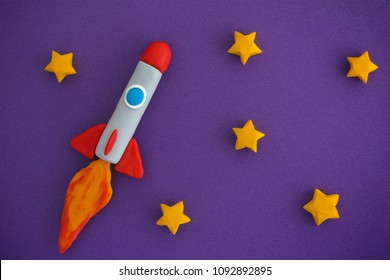 Space Rocket Flying For New Ideas Through The Stars. Space rocket is made out of play clay (plasticine).