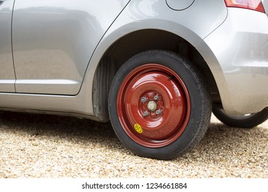 Space saver wheel and spare tyre or tire fitted to a small car