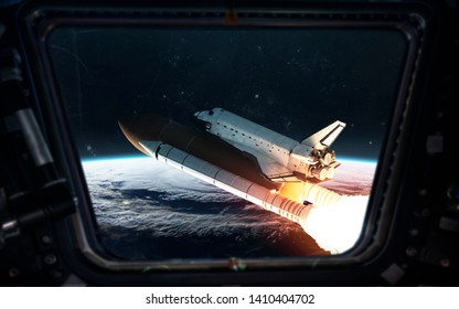 Space shuttle close to space station at Earth orbit. Elements of this image furnished by NASA