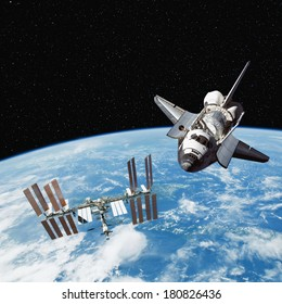 The Space Shuttle and International Space Station above the Earth, with stars in the Background. Elements of this image furnished by NASA.