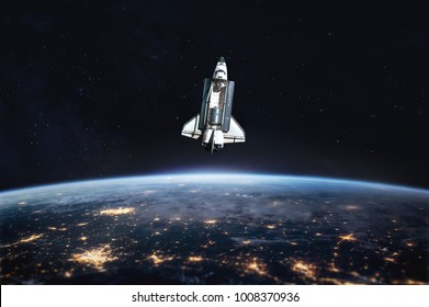 Space shuttle launch in the open space over the Earth. Blue gradient. Space art wallpaper. Focus on rocket. Elements of this image furnished by NASA