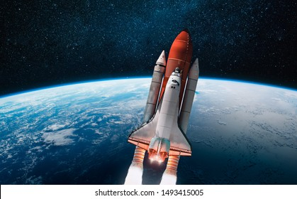Space shuttle over the Earth planet. Outer space. Explorating of the space. Elements of this image furnished by NASA