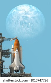 Space shuttle taking off on a mission. Elements of this image furnished by NASA.