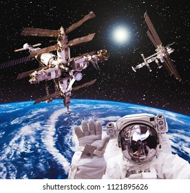 Space statation and spacecraft. Wonderful view from outer space. The elements of this image furnished by NASA.