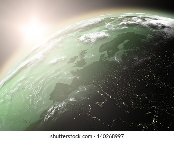 Space view of the sun rising over Europe on green planet Earth. Elements of this image furnished by NASA.