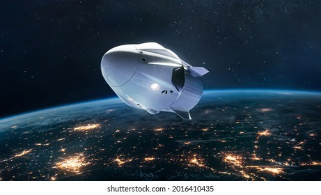 Spacecraft on orbit of Earth. Spaceship in outer space. Future and commercial tourism. Earth at night. Elements of this image furnished by NASA