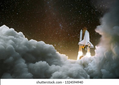 Spacecraft takes off into space. Start of the journey. Space Exploration. Rocket with smoke on the starry sky
