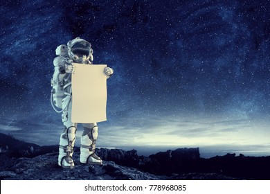 Spaceman with banner. Mixed media