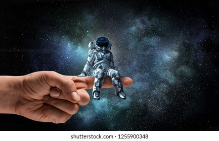 Spaceman on finger. Mixed media