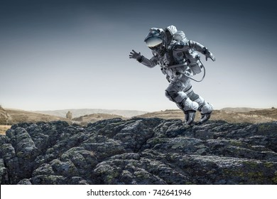 Spaceman running fast. Mixed media