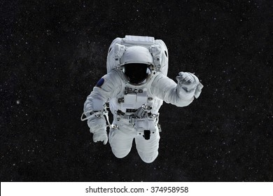 Spaceman travels on a background of stars. Astronaut outer space