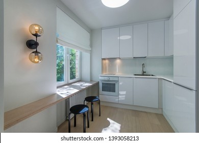 Space-saving solution for small kitchen. Bright small kitchen room