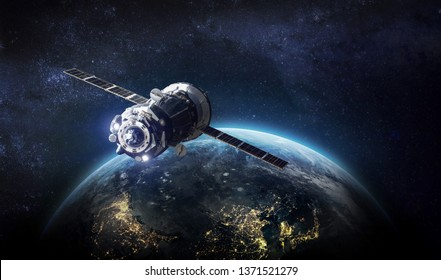 Spaceship and Earth on the background. Solar system. Elements of this image furnished by NASA