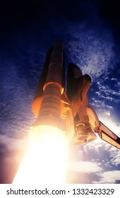 Spaceship launch in clouds. Rocket liftoff into space. The elements of this image furnished by NASA.