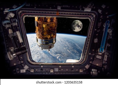 "spaceship next to the earth and the moon ""Elements of this image furnished by NASA"""