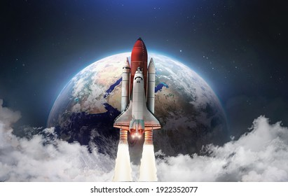 Spaceship in the outer space on orbit of Earth planet. Space shuttle in sky with clouds. Continents and oceans. Elements of this image furnished by NASA