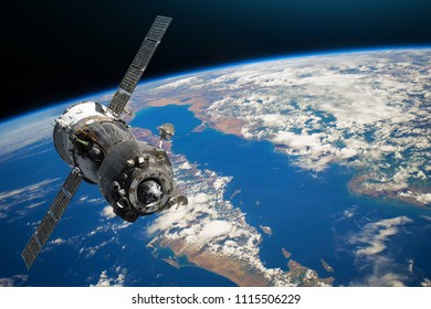 Spaceship piloted by astronauts in the orbit of planet Earth land and ocean, peninsula. Elements of this image furnished by NASA