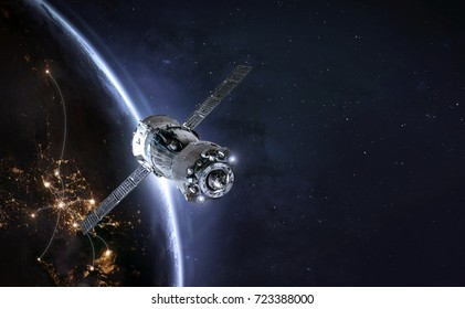 Spaceship in the space and earth in the night on the background. Communication between cities. Elements of this image furnished by NASA