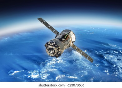 Spaceship in space and earth on the background. Astronomy and outer space conception. Distant galaxies and deep space. Elements of this image furnished by NASA