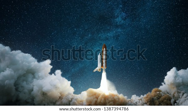 Spaceship takes off into the starry sky. Rocket starts into space. Concept