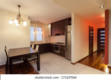 Spacious apartment - interior of kitchen in modern house