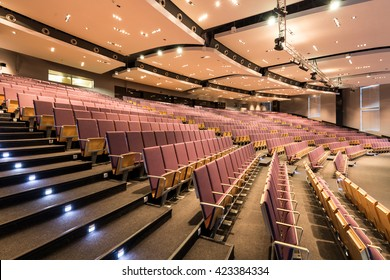 Spacious auditorium with rows of chairs and stairs