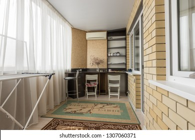 Spacious balcony with office area
