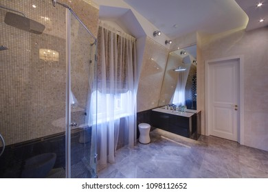 A spacious bathroom with a window and curtains