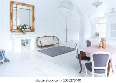 A spacious bright living room with a stylish modern design with elements of antique decor and beautiful chic vintage furniture