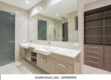 Spacious contemporary bathroom with walk in wardrobe