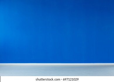 Spacious, empty interior with blue wall, and a blue floor