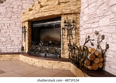 Spacious hall with the big fireplace