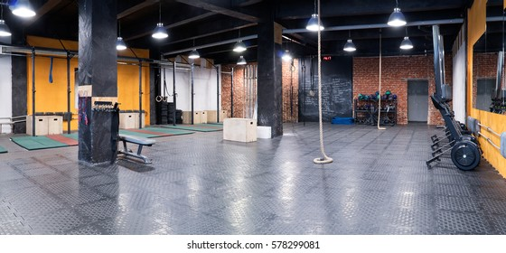 Spacious interior of a gym with sport equipment