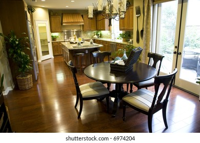 Spacious kitchen with table and island.