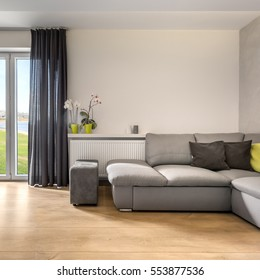 Spacious living room with balcony doors and large sofa