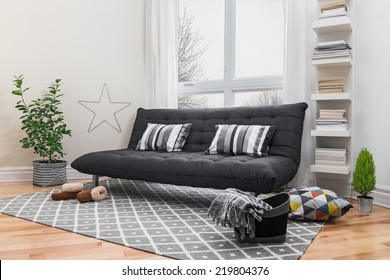 Spacious living room with gray sofa and modern decor.