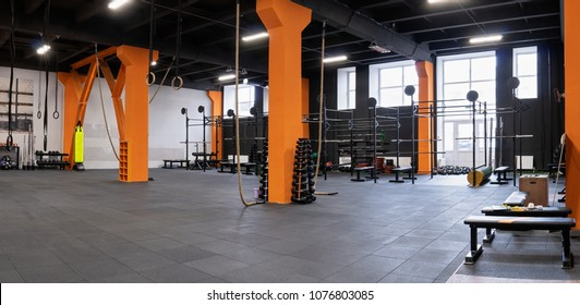 Spacious modern interior of the gym for fitness training with equipment