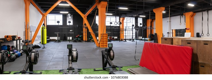 Spacious modern interior of the gym for fitness training with machines and equipment