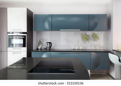 The spacious modern kitchen in the apartment. Modern kitchen design solution