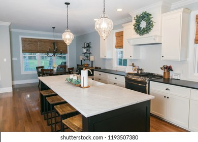 Spacious Modern Kitchen with Dark Cabinets Wood Floors Marble Island