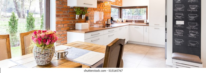 Spacious modern kitchen joined with a very stylish dining room with a large window overlooking the garden