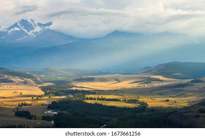 Spacious mountain valley. Cloudy weather. Natural light, panoramic view, light in the valley.
